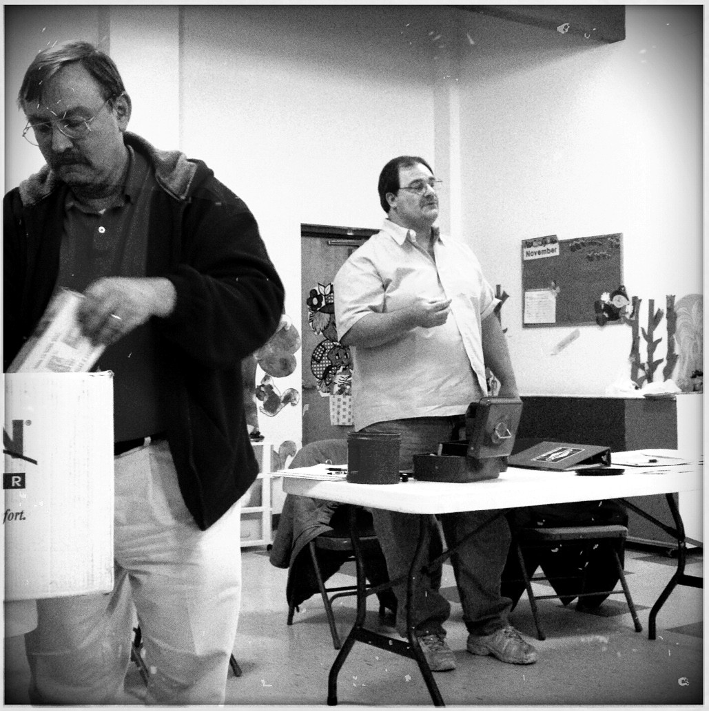 President Brian Starkes leads a club meeting in 2011 while Gary Telecsan attends to treasurer business.