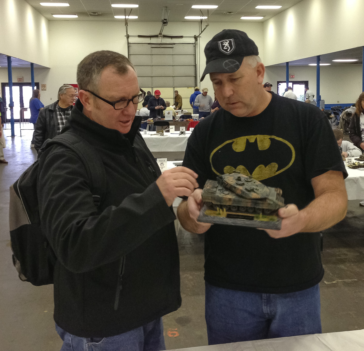 HRSM member Kevin Farris, right, shows off his Leopard tank to an interested ODO attendee. The model won a first in its category at the show.