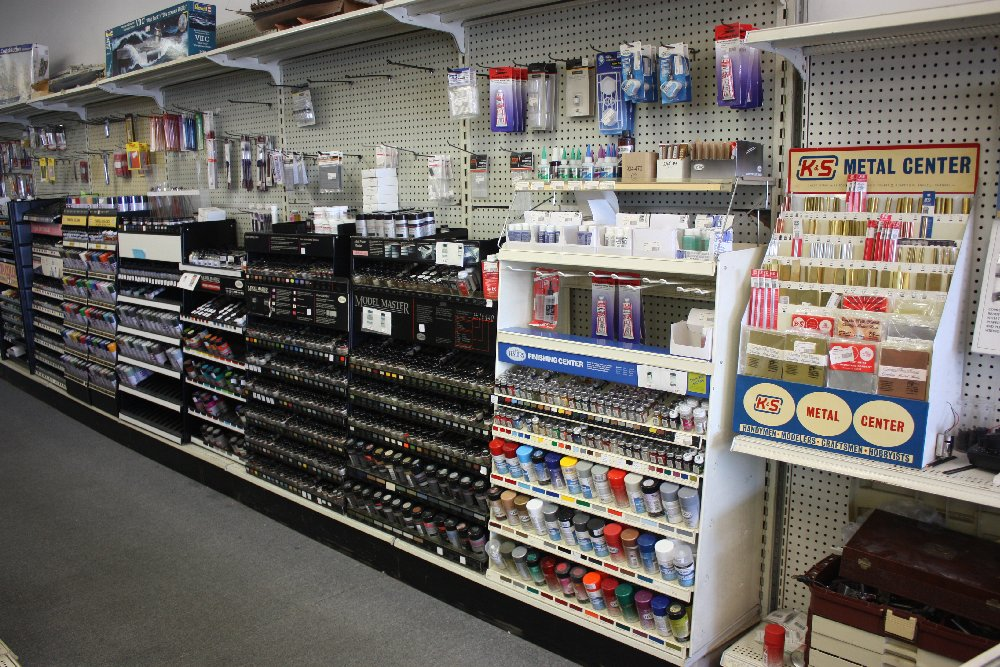 Full range of modeling paints & glues (and some brass stock.)